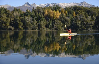 Kayaker in front of mountains